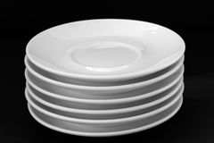 White plates. Isolated on black background Stock Images
