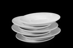 White plates. Isolated on black background Royalty Free Stock Photos