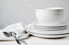 White plates and bowls Royalty Free Stock Images