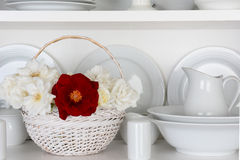 White Plates in Cupboard and One Red Rose Royalty Free Stock Image