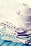 White plates and cups on blue napkins Royalty Free Stock Image