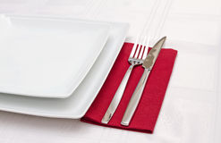 White plates with cutlery Stock Photos