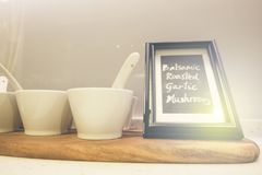 White plates and dinnerware display on shelf with light flare effect Royalty Free Stock Photos