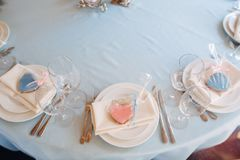 White plates with pink and blue heart form cookies on plates. White plates on blue tablecloth, pink and blue heart form cookies on plates Royalty Free Stock Photo
