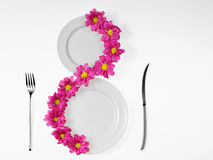white plates and pink flower Stock Images
