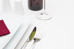 White plates and red wine bottle Royalty Free Stock Photo