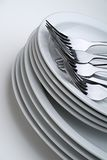 White Plates and Silverware Stock Image