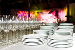 White plates and stemware glass at Royalty Free Stock Photography