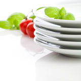 White plates on the table Stock Images