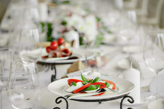 White plates are on the table in restaurant. Royalty Free Stock Images