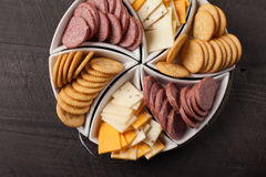 White Platter of Crackers, Cheese, and Meat above shot Royalty Free Stock Photo