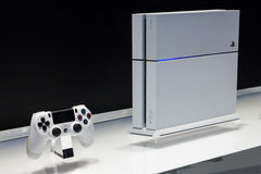 White PlayStation 4. LOS ANGELES - JUNE 12:  Sony unveiling white PlayStation 4 model for the first time at E3 2014, the Expo for video games on June 12, 2014 in Stock Image