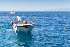 White pleasure boat floating on sea water. Zakynthos, Greece - August 20, 2016: White pleasure boat floating on sea water in summer day Stock Photo