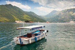 White pleasure boat floats in Kotor Bay Royalty Free Stock Photo