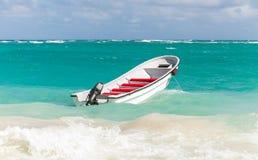 White pleasure boat floats on stormy ocean water. White pleasure boat floats on stormy waves. Dominican republic. Coast of Atlantic ocean Stock Photography