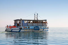 White pleasure boat full with tourists Royalty Free Stock Image