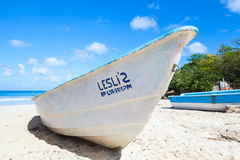 White pleasure boat lays on sand Royalty Free Stock Photos