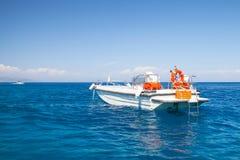 White pleasure motor boat floating on sea water. Near Zakynthos island, Greece Royalty Free Stock Image