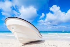White pleasure motor boat lays on sandy beach Royalty Free Stock Image