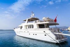 White pleasure motor yacht  stands moored in Izmir Stock Photo