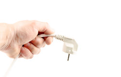 White plug in hand Stock Images