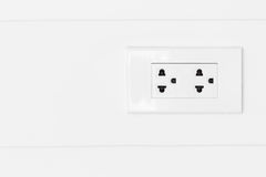 White plugs on white wood wall. Royalty Free Stock Images