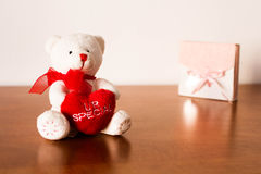 White Plush Teddy Bear. Hugging a red heart that says you are special Stock Image