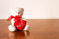 White Plush Teddy Bear. Hugging a red heart that says you are special Stock Photo