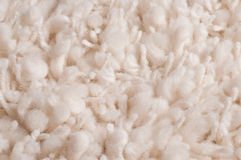 White plushy knotted carpet. Knotted natural white woolen carpet, detail Stock Image