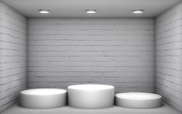 White podium in a brick room Royalty Free Stock Photos
