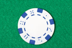 White poker chip on the casino table Stock Photos
