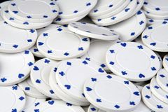 White poker chips. On a table Royalty Free Stock Photos