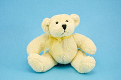 White polar bear toy on azure background Royalty Free Stock Images