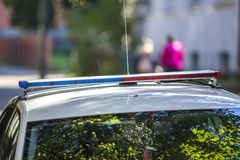 White police car cruiser with emergency lights parked on sunny summer street. Security and control in modern life.  royalty free stock images