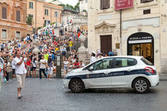 White Police car stands on street in Rome Stock Photos