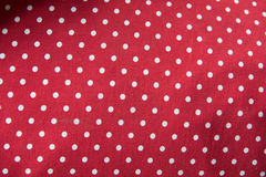 White polka dot pillow Royalty Free Stock Image