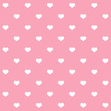 White polka dots hearts on pink background Royalty Free Stock Image