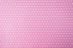 White polkadot with pink background Royalty Free Stock Images