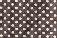 White polkadots on brown. Background Stock Photo