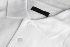 White poloshirt with blank black label Stock Image