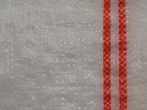 White polyethylene with red stripes Royalty Free Stock Photography