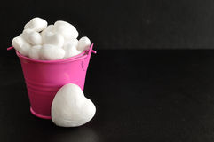 White polystyrene hearts in a pink bucket Royalty Free Stock Photo