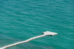 The white pontoon as walkway on the sea Royalty Free Stock Photography
