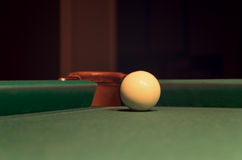 White Pool Ball on Billiard Table Near the Hole Royalty Free Stock Images