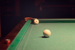 White Pool Ball on Billiard Table Near the Hole Stock Image