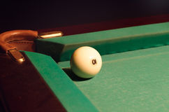 White Pool Ball Near Hole of the Table Stock Image