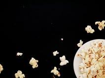 White popcorn on the black cloth Royalty Free Stock Photos