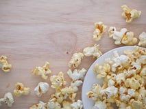 White popcorn on the wood Royalty Free Stock Image