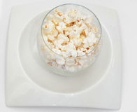 White popcorns on white plate on white background Royalty Free Stock Photo