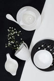 White porcelain on black and white linen tablecloths. Royalty Free Stock Photos